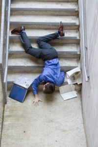Person on the floor in front of the stairs